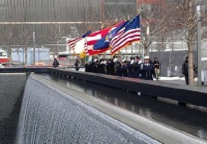 Image of 9-11 Memorial with Fireman Marching with Flags